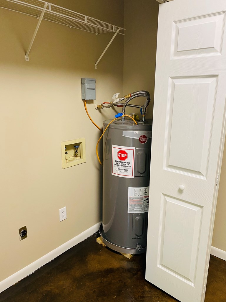 NEW HOT WATER HEATER IN WASHER AND DRYER ROOM